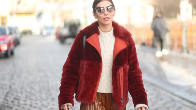 Masha Sedgwick wearing Acne boots Strenesse lambskin jacket HM pleated skirt Celine bag is seen during the Berlin Fashion Week January 2018 at...