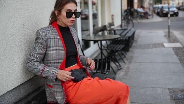 Masha Sedgwick wearing black cropped top Asos orange skirt with slit Sies Marjan black belt bag Gabriele Frantzen Superga platform sneakers Lala...