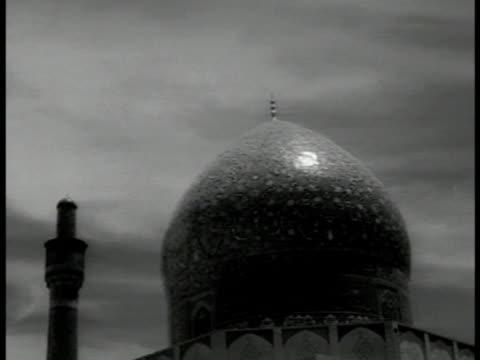Masjidi ShahMasjidi Shah in Isfahan Dome of mosque w/ glazed tile mosaic Praying Muslims 134223 Seated Shia Islamic cleric Ayatollah Kashani talking