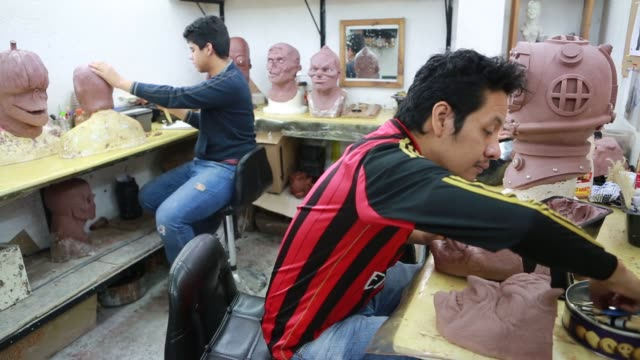 mask designers work on oil based modeling clay for a new mold for a mask at the rev mask company in cuernavaca mexico employees inside the rev... - airbrush stock videos & royalty-free footage