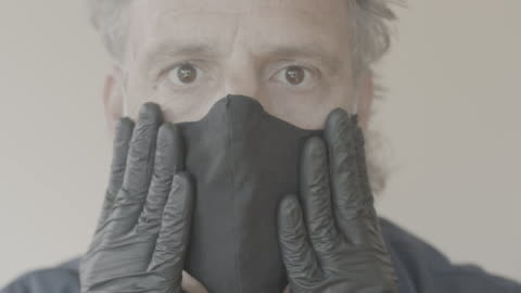 vídeos y material grabado en eventos de stock de mask gloves and glasses for covid-19 protection - guante quirúrgico
