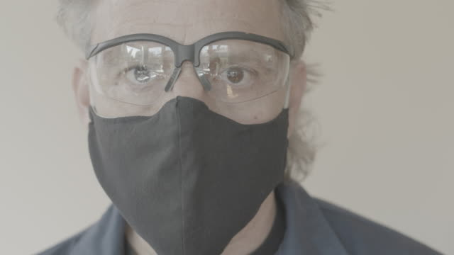 mask gloves and glasses for covid-19 protection - latex glove stock videos & royalty-free footage