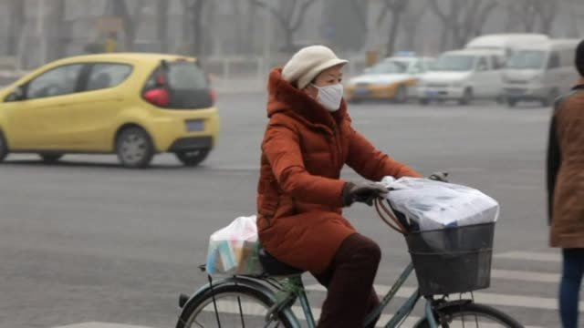 Mask wearing Beijing residents endure a third day of pollution at hazardous levels as authorities warn that a thick cloud of smog may not be lifted...