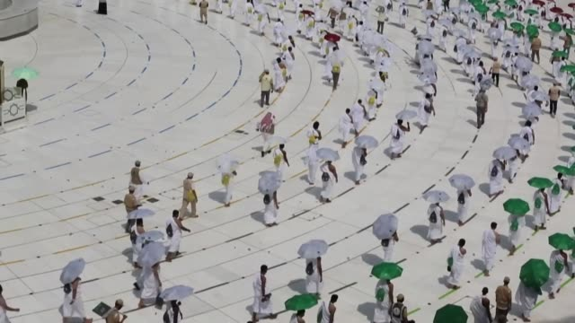 mask-clad muslim pilgrims begin the annual hajj, dramatically downsized this year as the saudi hosts strive to prevent a coronavirus outbreak during... - pilgrimage stock videos & royalty-free footage