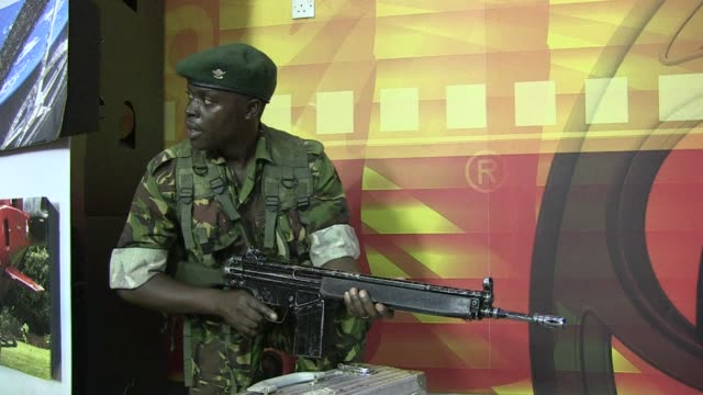 masked attackers stormed a packed upmarket shopping mall in nairobi on saturday, spraying gunfire and killing 30 people and wounding dozens more... - holing stock videos & royalty-free footage