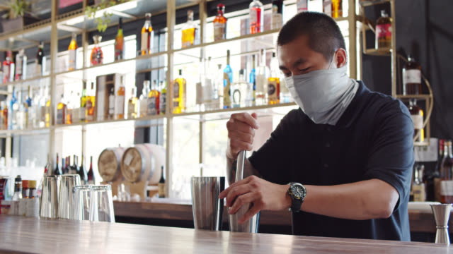 Masked Bartender Muddling Ingredients