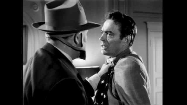 1952 A masked boss beats a gangster