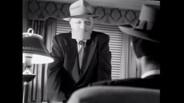 1952 a masked boss warns a gangster about the repercussions of another failed heist - film noir style stock videos and b-roll footage
