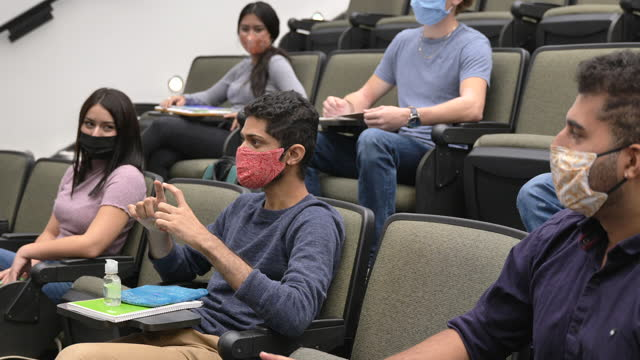 masked college students in a lecture hall - classroom stock videos & royalty-free footage
