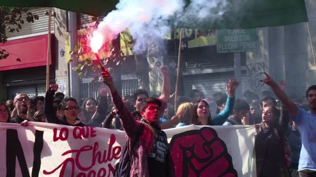 masked demonstrators threw stones and police fought back with tear gas and water cannon thursday in chile as tens of thousands of students hit the... - water cannon stock videos & royalty-free footage
