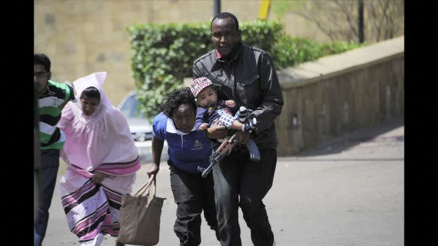 masked gunmen stormed an upmarket mall in nairobi saturday and sprayed gunfire on shoppers and staff, killing at least 13, before holing themselves... - holing stock videos & royalty-free footage