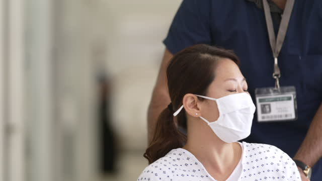 masked hospital patient - male nurse stock videos & royalty-free footage