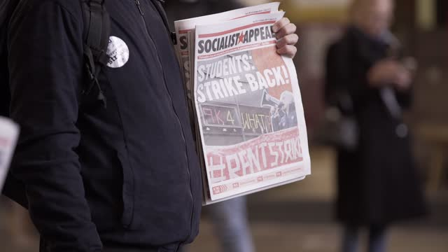 masked man holding newspaper - students strike back headline during the second wave of the coronavirus pandemic on october 31, 2020 in manchester,... - newspaper strike stock videos & royalty-free footage