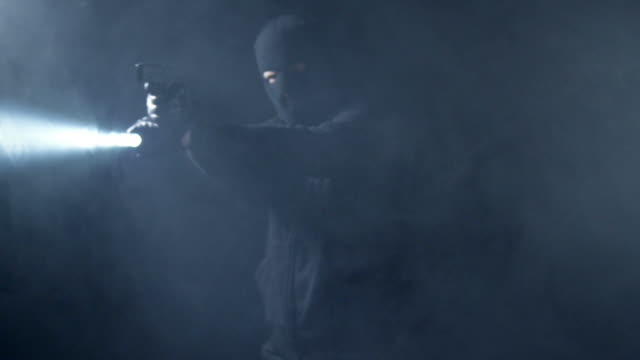 masked man in fog - electric torch stock videos & royalty-free footage
