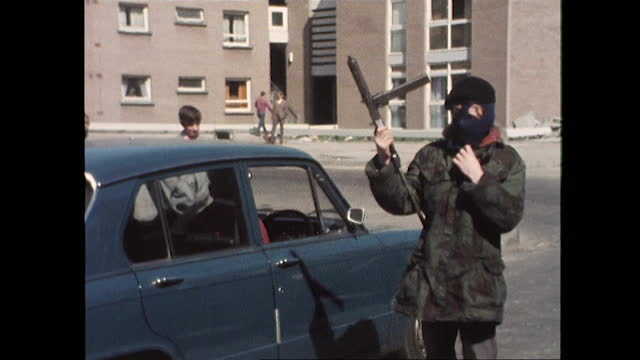 masked members of official ira man checkpoint at entrance to bogside, londonderry - geographical locations stock videos & royalty-free footage