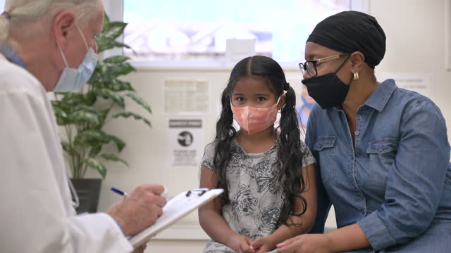 masked paediatrician appointment - fatcamera stock videos & royalty-free footage