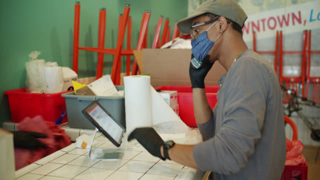 Masked Restaurant Employee Taking Order on Phone During Covid-19 Lockdown