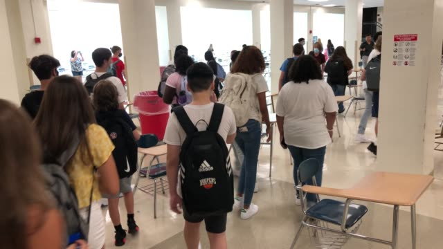 masked students arrive at the cafeteria for lunch during the first day of school at stamford high school on september 08 in stamford, connecticut.... - canteen stock videos & royalty-free footage