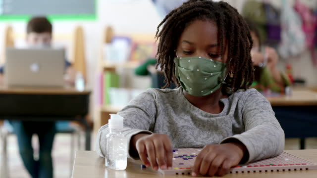 masked students in classroom during covid-19 - primary age child stock videos & royalty-free footage