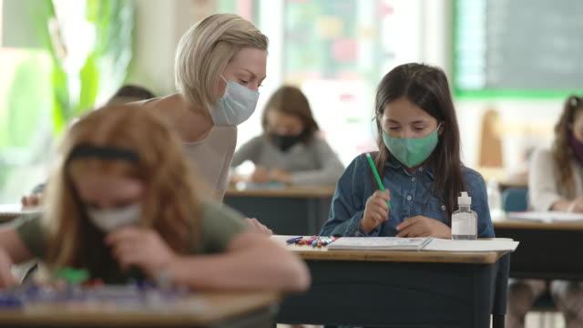 masked teacher in class - preschool stock videos & royalty-free footage