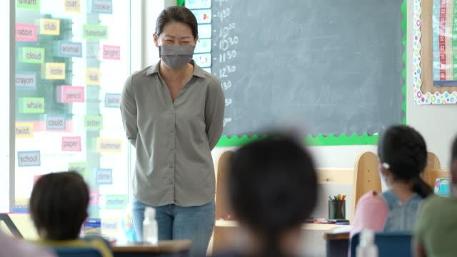 masked teacher - pacific islander teacher stock videos & royalty-free footage