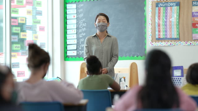masked teacher - chinese ethnicity stock videos & royalty-free footage