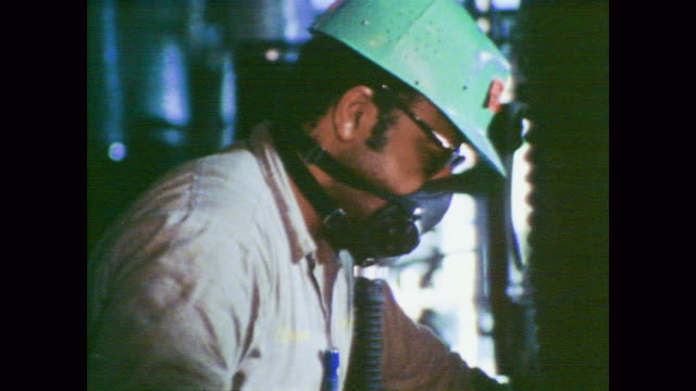 1978 masked workers create polyvinylchloride (pvc) resin - protective workwear stock videos and b-roll footage