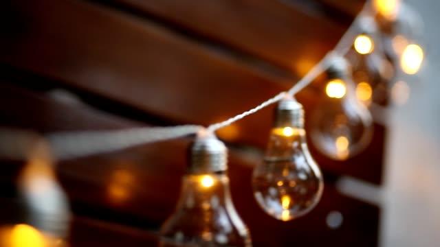 mason jar candle hanging on tree for wedding decor - lanterna attrezzatura per illuminazione video stock e b–roll