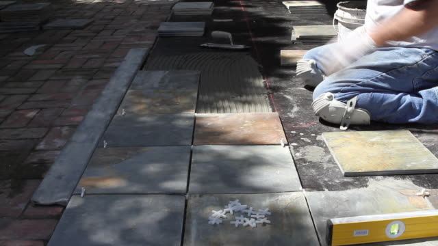 ms mason positioning tile into place / north hollywood, california, usa - positioning stock videos & royalty-free footage