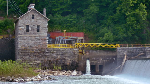 masonry dam water power station up close 4k - watermill stock videos and b-roll footage