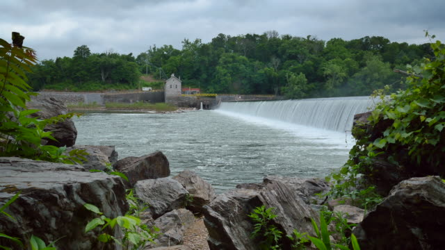 masonry dam water power station with rock edge wider 4k - watermill stock videos and b-roll footage