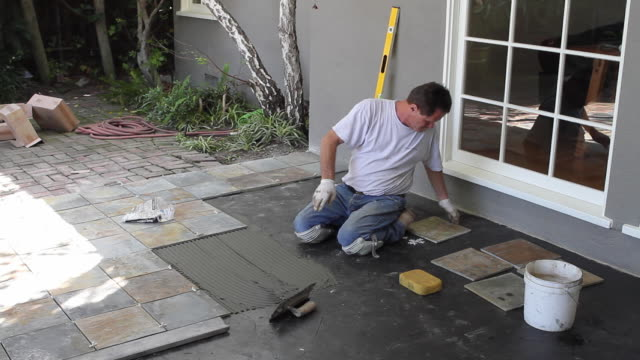 Ws Masons Adjusting Tile Into Place North Hollywood California Usa