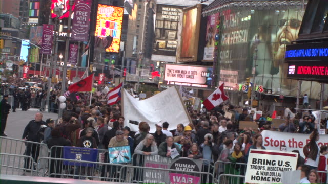mass amounts of protesters gather in streets of time square during occupy wall street movement audio / new york city, new york, united states - occupy protests stock videos & royalty-free footage