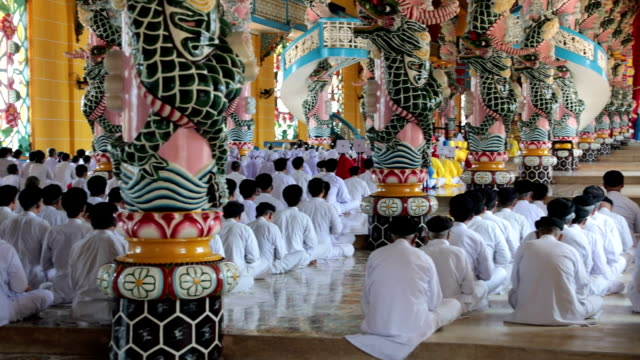 mass celebration in the temple of cao đài religion's holy see, tây ninh, vietnam - worshipper stock videos & royalty-free footage