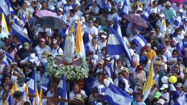 mass demonstration sponsored by the catholic church takes place in managua with busloads of demonstrators brought in from rural areas following a... - managua stock videos & royalty-free footage