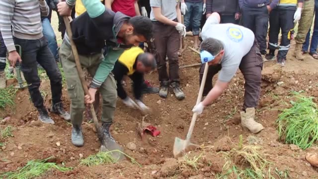 a mass grave containing 59 bodies of free syrian army members killed by pyd/pkk terror group two years ago was discovered in syria's afrin region the... - mass grave stock videos and b-roll footage
