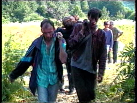 fears that evidence is being lost lib herzegovina srebrenica muslim men along carrying wounded man on stretcher then bosnian serb military commander... - bosnia and hercegovina stock videos & royalty-free footage