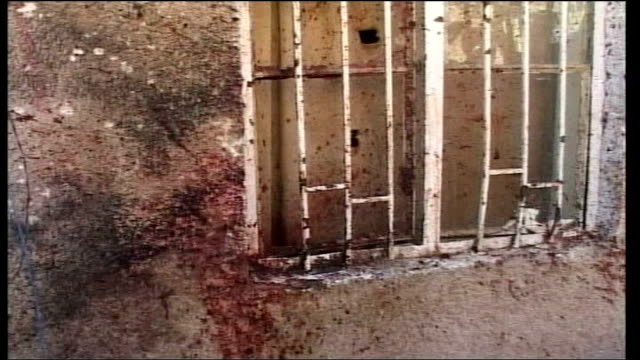 mass kidnapping at the baghdad education ministry; via aptn ramadi: men standing around blood and abandoned shoes on ground following us raid in... - kidnapping stock videos & royalty-free footage