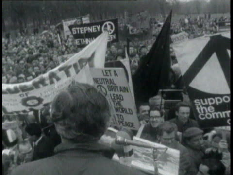 stockvideo's en b-roll-footage met mass may day antinuclear demonstration / demonstrators with banners george brown speaking at mics angry demonstrators demonstrators pushing against... - 1965