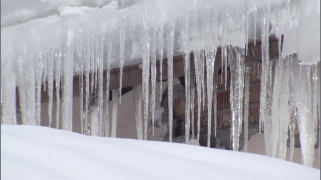 ms mass of icicles hanging from eaves of building / galtur, tyrol, austria - eaves stock videos and b-roll footage