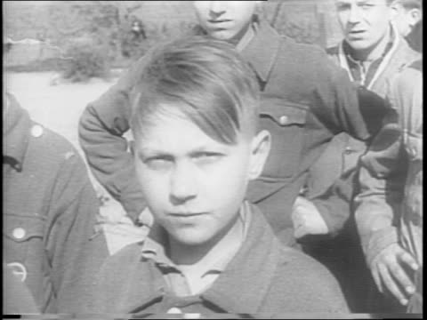 mass of nazi prisoners / prisoners behind barbed wire / civilians look at prisoners from distance / mass shot of nazi prisoners standing crowded... - hungrig stock-videos und b-roll-filmmaterial