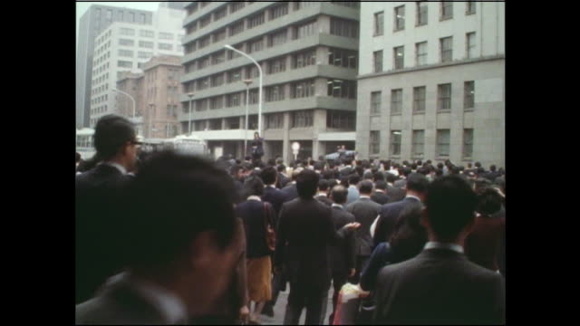 a mass of pedestrians cross a busy street. - 1978 stock videos and b-roll footage