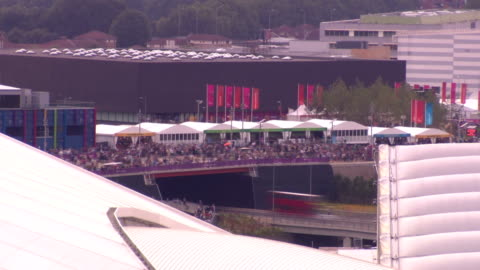 stockvideo's en b-roll-footage met mass of people cross one of the main bridges in front of the copper box in the london 2012 paralympic park. time-lapse paralympic crowds at olympic... - 2012