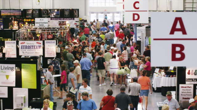 mass of people in a crowded exhibition building at a state fair. - exhibition stock videos & royalty-free footage