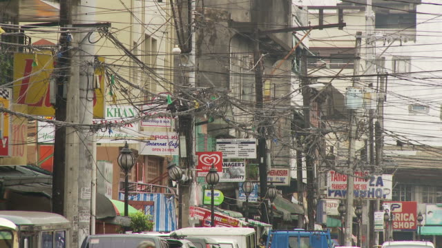 mass of power electrical lines in manila philippines - ペディキャブ点の映像素材/bロール