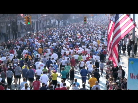 mass of runners at start of manchester road race away from camera mass of runners away from camera on january 01 2012 in manchester ct - salmini stock videos & royalty-free footage