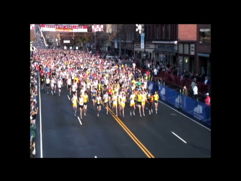 mass of runners down main street manchester ct to start race mass of runners down main street at start of race on november 20 2009 - salmini stock videos and b-roll footage