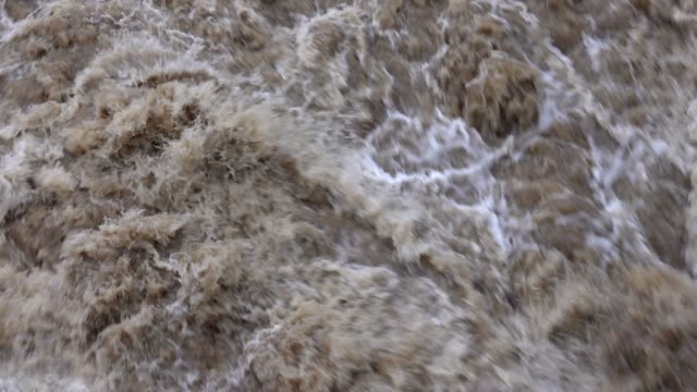 mass of water at flood at dam, saar river, mettlach, saarland, germany - überschwemmung stock-videos und b-roll-filmmaterial