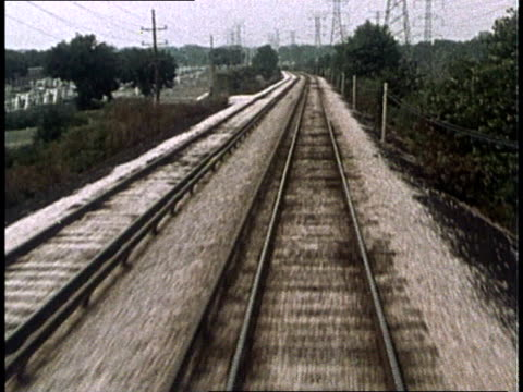 1975 montage mass transit train system in skokie / skokie, illinois, united states - illinois stock-videos und b-roll-filmmaterial