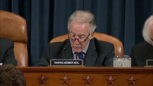 Massachusetts Congressman Richard Neal reads from prepared remarks at a hearing on tariffs imposed by the Trump administration telling Commerce...